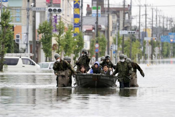 Japan warns of more heavy rain in flood-hit areas