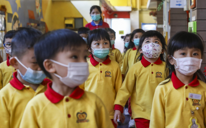 Hong Kong to shut down schools amid virus spike