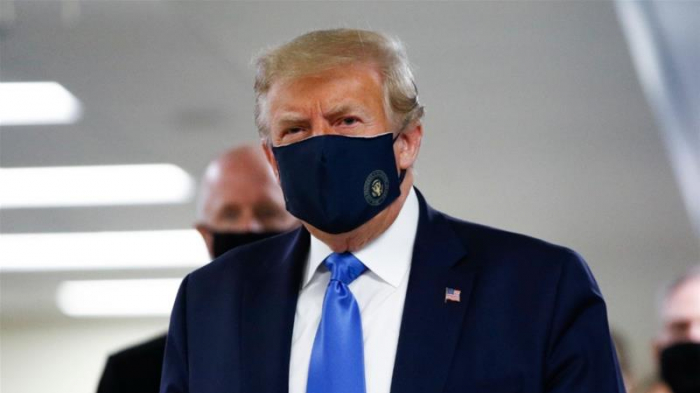 In first, Trump dons masks in visit to a military medical facility
