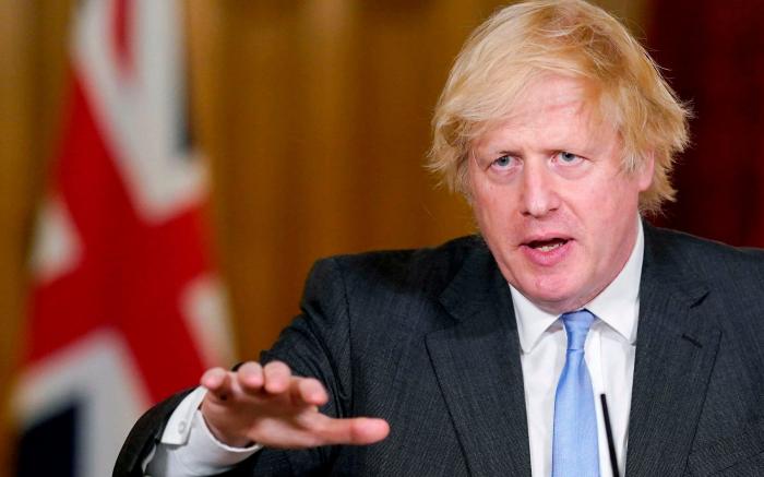 UK PM Johnson: We will be past coronavirus by mid-2021