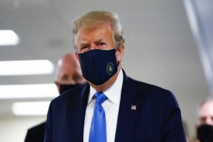 Trump wears mask, voices hope on coronavirus vaccine in North Carolina