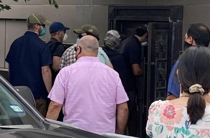 Men seen forcing open backdoor of China