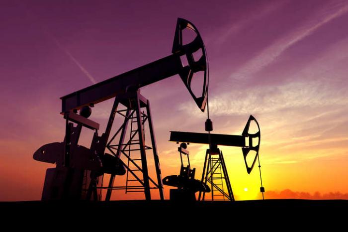 Oil falls slightly after jump on U.S. stocks draw