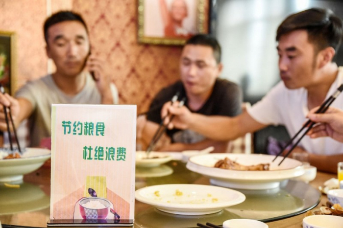 Chinese restaurant apologises for weighing customers before they order food