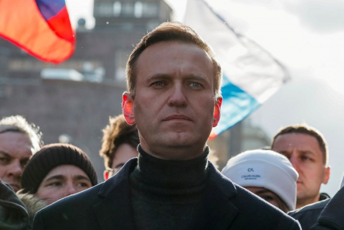 Russian opposition leader Navalny hospitalized after suffering symptoms of poisoning