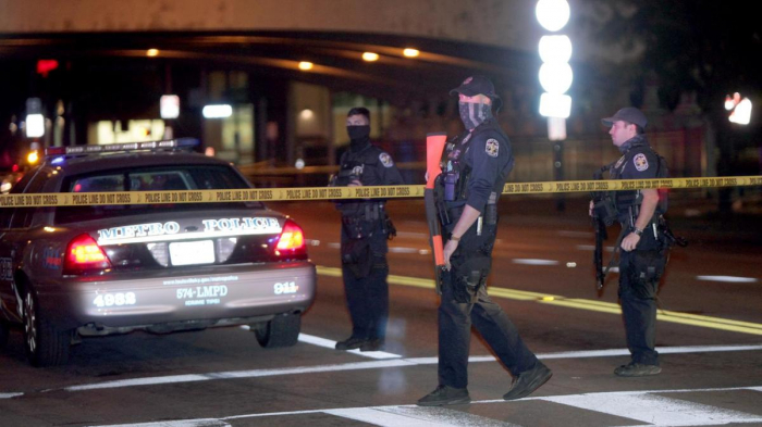 Two police officers shot amid Louisville protests