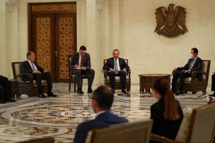 Russian delegation holds talks with Assad as Syrian economy crumbles