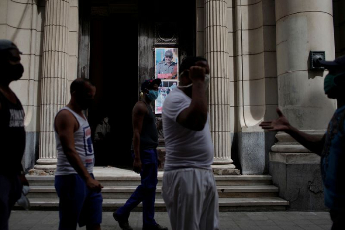 Cuba projects first official peso devaluation since 1959 revolution