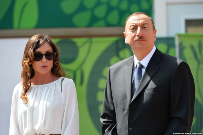 President Ilham Aliyev and first lady Mehriban Aliyeva view landscaping work carried out in Balakhani