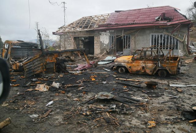 Corpses and burnt-out cars line Karabakh road as Russian peacekeepers deploy