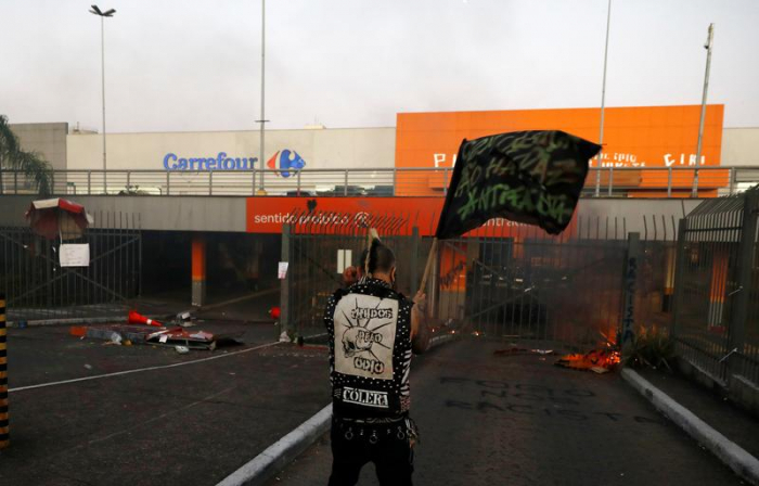 More than 1,000 demonstrators attack Carrefour after Black man beaten to death