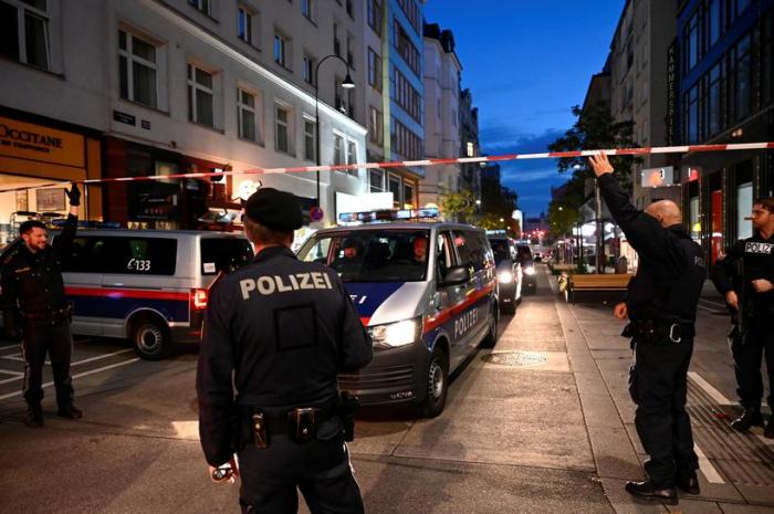 Austrian police detain 14 in dragnet following gunman kills four on rampage