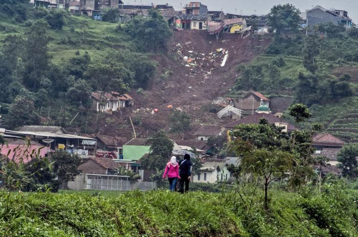 At least 13 dead, 26 missing as landslides hit Indonesia