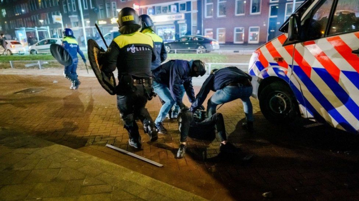 Dutch police detain more than 180 in nationwide unrests