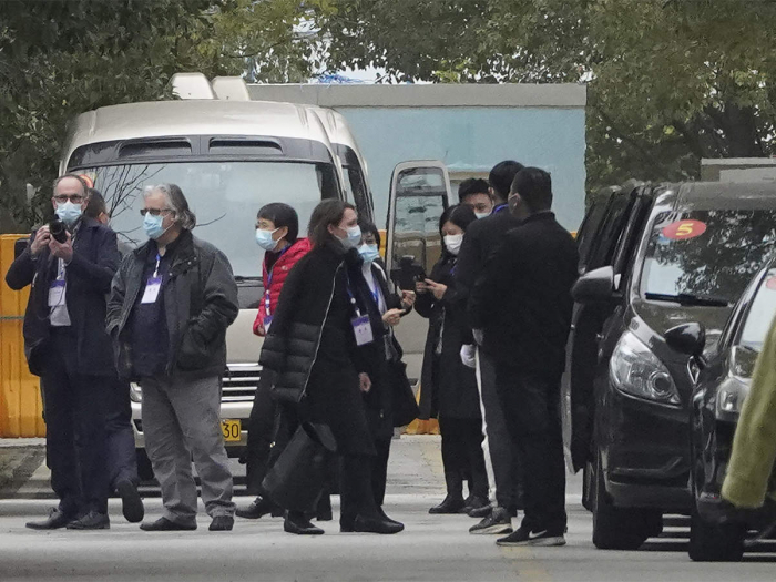 WHO team, on tightly controlled China mission, visits hospital