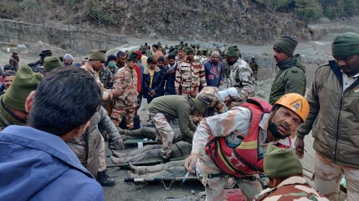 14 dead, 150 missing after India glacier bursts dam