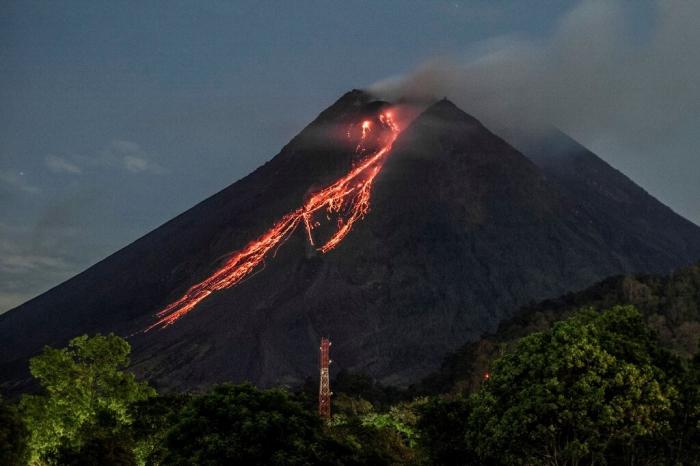 Indonesia volcano erupts, spews red-hot lava