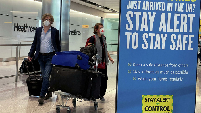 Foreign travel curbs to stay until at least mid-May, British PM says