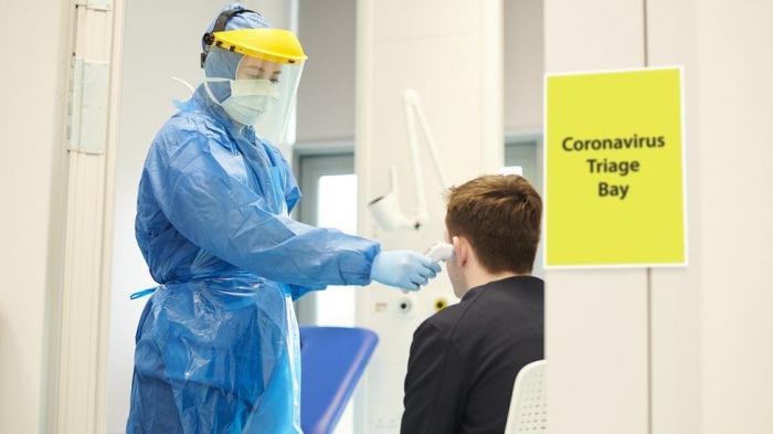 Covid-19: Officials hunt Brazil virus variant case in England