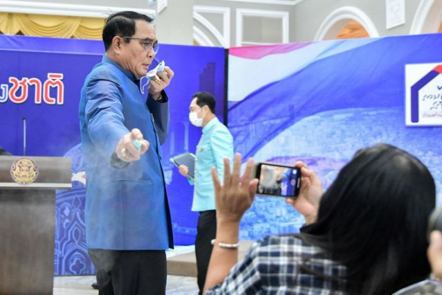 Thai PM sprays sanitiser on reporters -  NO COMMENT
