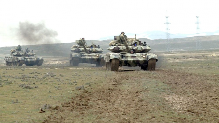 Azerbaijani troops involved in large-scale exercises deploying in concentrated areas