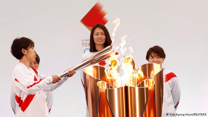 Japan lights Olympic torch after one-year Covid delay -   VIDEO