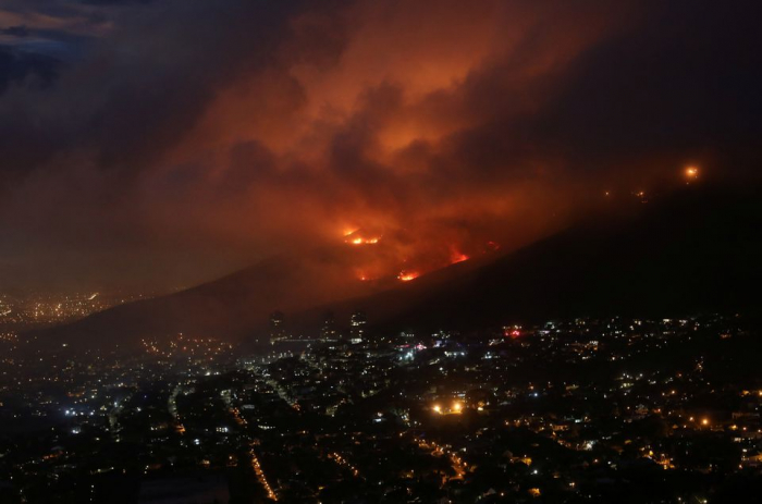 Firefighters fight to contain fire on S.Africa