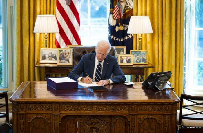 Biden signs order keeping Trump-era refugee cap at 15,000