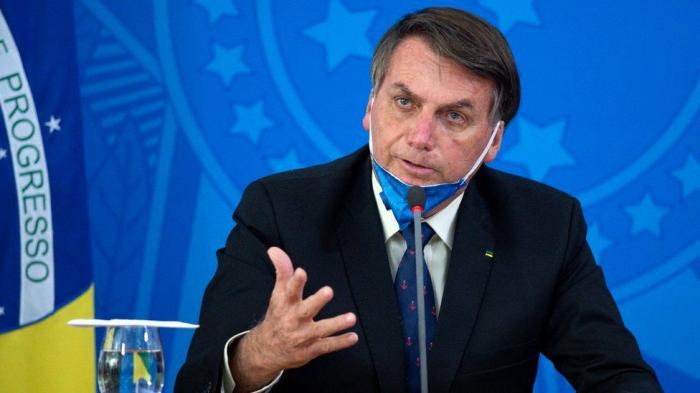 Brazil fines Bolsonaro for ignoring COVID-19 rules