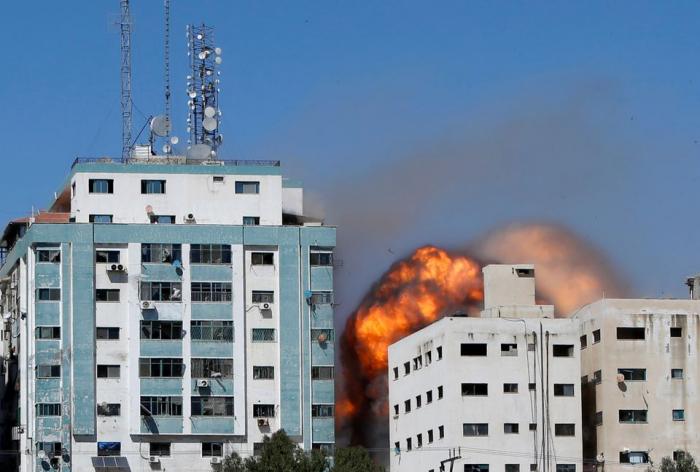 Gaza tower housing AP, Al Jazeera collapses after missile strike - witness