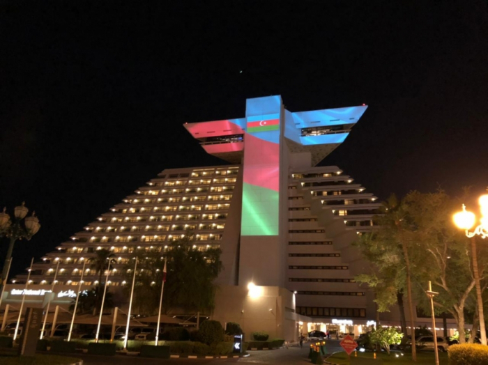 Qatar's iconic building lit up with colors of Azerbaijani flag