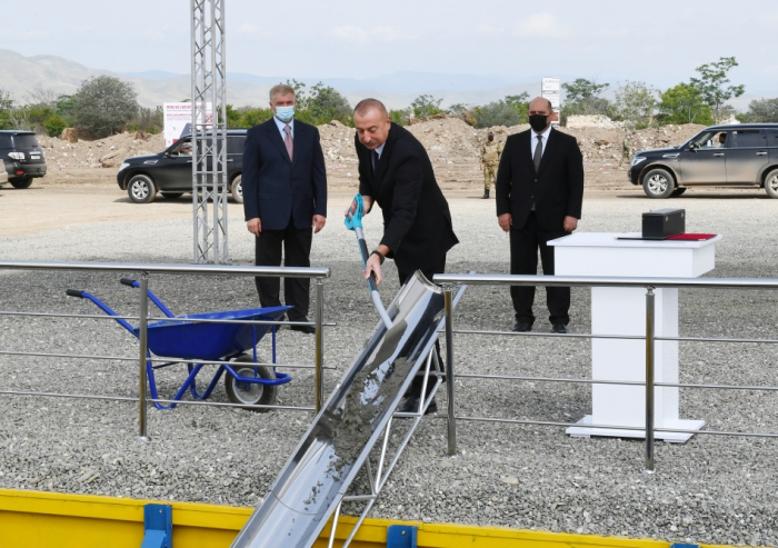 Azerbaijani president lays foundation stone for first residential building in Aghdam