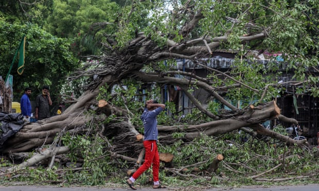 Death toll rises to more than 90 after huge storm hits India