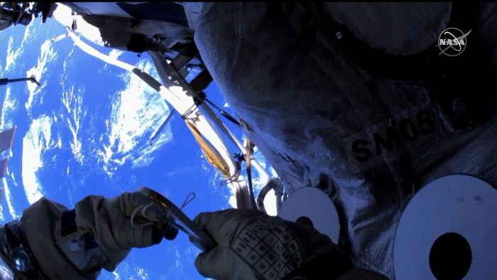 Cosmonauts Oleg Novitsky and Pyotr Dubrov conduct spacewalk from the ISS -   NO COMMENT