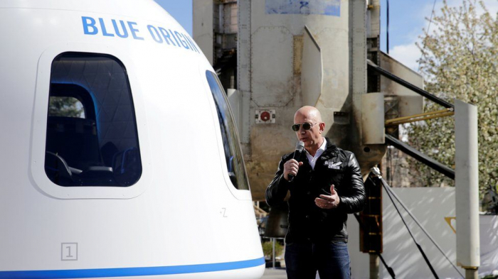 Bidder pays $28m for space trip with Amazon