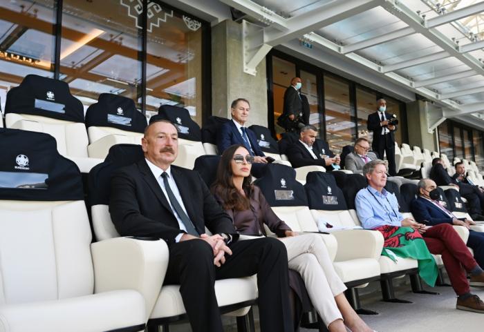 Azerbaijani president, first lady watch football match between Switzerland and Wales