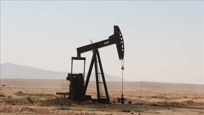Oil prices jump as demand outlook improves