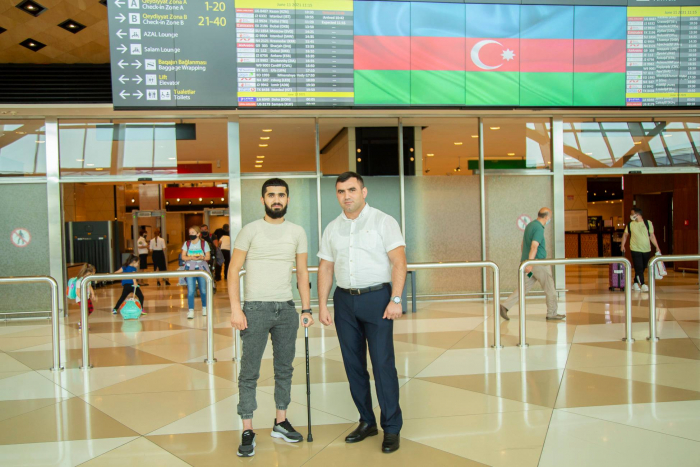 Four more Azerbaijani war veterans return home after receiving treatment in Turkey -  PHOTO