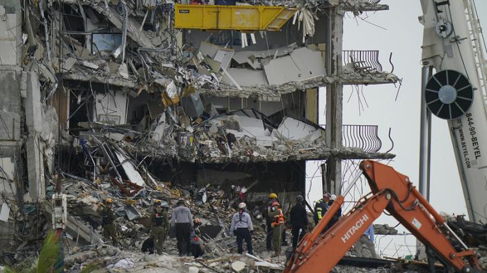 Biden heads to Florida condo collapse site, death toll at 18
