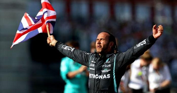 Hamilton overcomes crash and time penalty to claim British GP