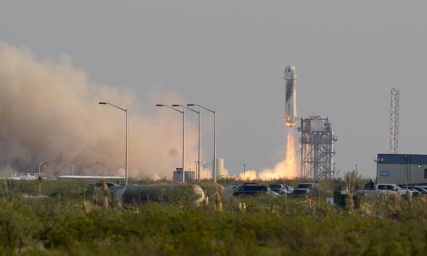 Bezos rides rocket on company's first flight with passengers