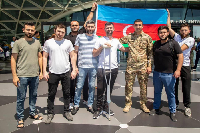 Six more Azerbaijani war veterans return home after undergoing treatment in Turkey