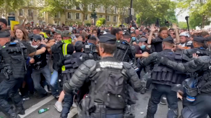 Clashes at Paris protest over virus passes -   OPINION
