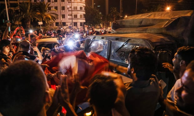 Tunisia's president imposes month-long curfew and bans gatherings