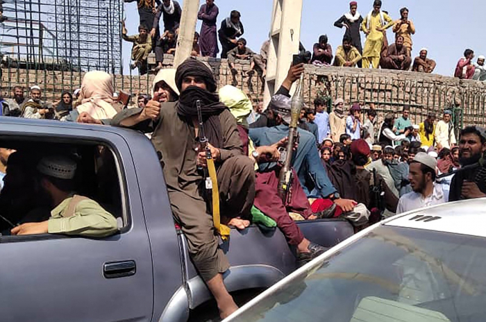 Afghan President Ghani relinquishes power, Taliban form interim gov