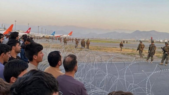 Twelve people dead in stampede and shootout at Kabul airport