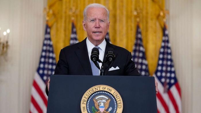 US troops may stay past withdrawal deadline - Biden