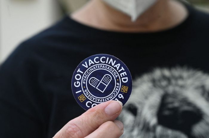 What are the efforts to distribute COVID-19 vaccines globally? -   iWONDER