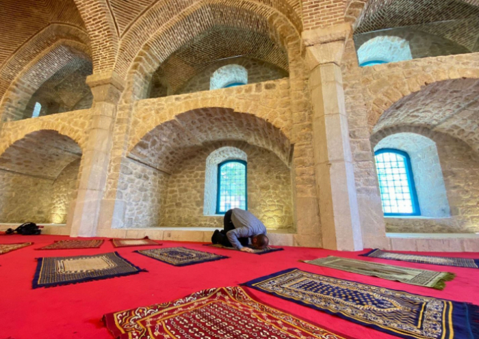 Natives of Shusha perform prayer at Govhar Agha mosque