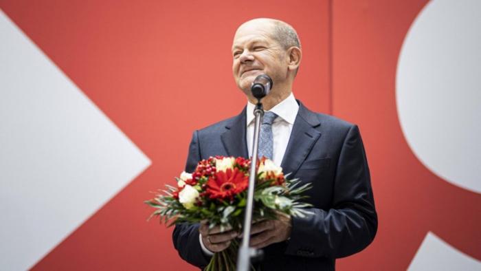 Zu Wahlerfolg    gratuliert Bundeskanzlerin Angela Merkel den Olaf    Scholz